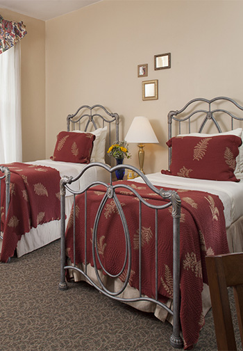 twin silver painted iron beds with white and burguny linens