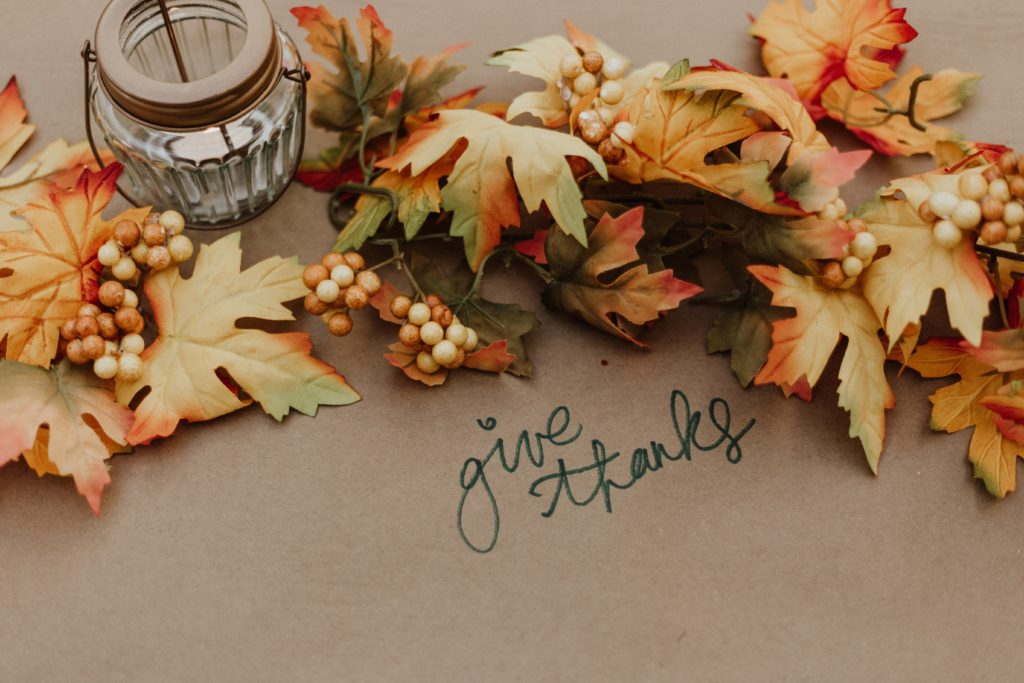 leaves-on-brown-paper-with-candle-tablespread-priscilla-du-preez